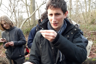 Alex Duncan with a handful of dormice nibbled hazelnuts