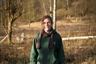 Elaine stands on a nature reserve