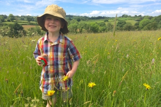 Bryn playing in a meadow