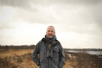 Dave stands on a nature reserve