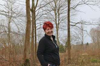 Anne standing in a woodland