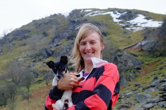 Emma with her dog in the hills