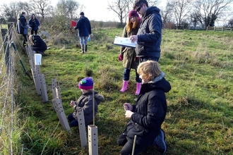 Volunteers of all ages socially distanced tree planting!
