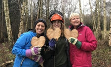 Skylarks volunteers holding wooden hearts