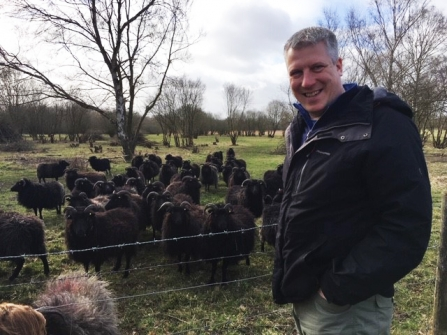 Picture of Paul Wilkinson standing near some sheep